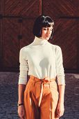 High Waisted. Femininity And Emphasize Feminine Figure. High Waisted Trousers Keep Returning To Catw poster