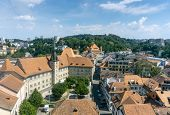 Top View Of The Historical Part Of The Famous Swiss City Of Lausanne. Bright Blue Sky With Small Whi poster