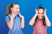 Its Funny. Funny Children. Funny Little Girls Enjoy Playing Together. Small Kids Gesturing And Makin poster