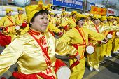 FLUSHING, NY - FEBRUARY 12: Falun Gong members stand as they participate in Chinese New Year celebra