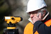 picture of cartographer  - Civil engineer with surveying equipment - JPG