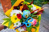 A Bouquet Of Flowers And Various Items For Schoolchildren And Students. poster