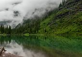 Fog Entering Avalanche Lake Area In Montana Wilderness poster