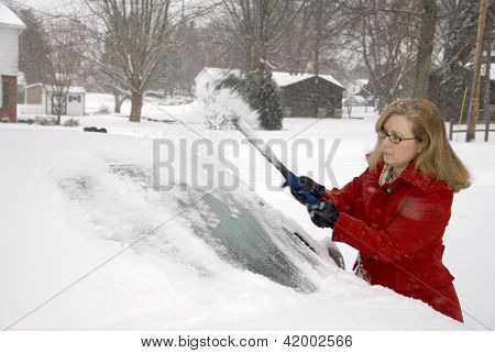 Woman Removing Snow From Car 8
