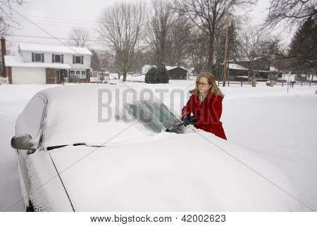 Woman Removing Snow From Car 7