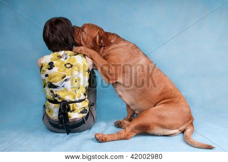 Girl with her loving dog kissing her master