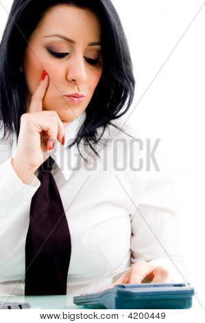 Woman Operating Calculator