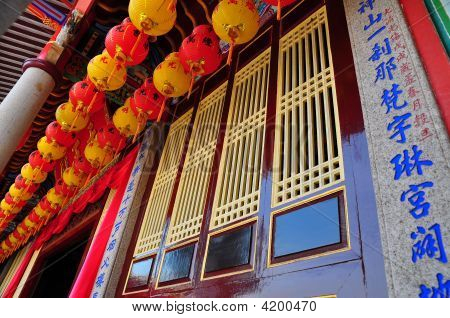 Lanterns Above Traditional Window Frames