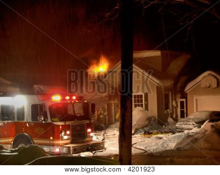 House Fire In Winter Storm
