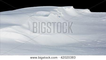 Deep Snow Drift Isolated On Black