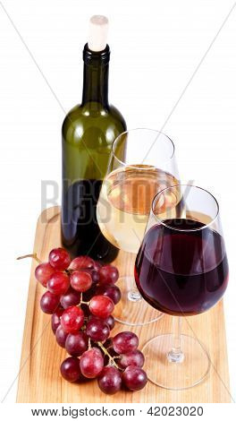 Two Wine Glasses With Red And White Wine, Bottle Of Wine And Grapes