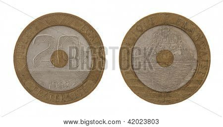Old French 20 franc coin depicting Mont Saint Michel. Obverse and reverse isolated on white.