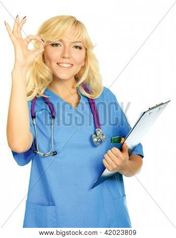 Smiling doctor woman in blue uniform with stethoscope showing okay sign  isolated on white background