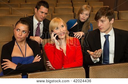 Woman In The Audience Annoying Others With A Cellphone