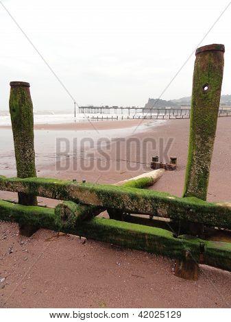 Beach Groin Seascape With Pier