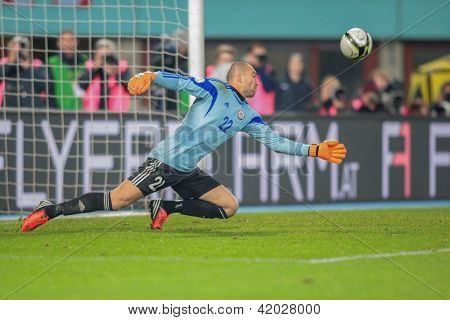 VIENNA,  AUSTRIA - OCTOBER 16:  Andrei Sidelnikov (#22 Kazakhstan) deflects the ball during the WC qualifier soccer game on October 16, 2012 in Vienna, Austria.