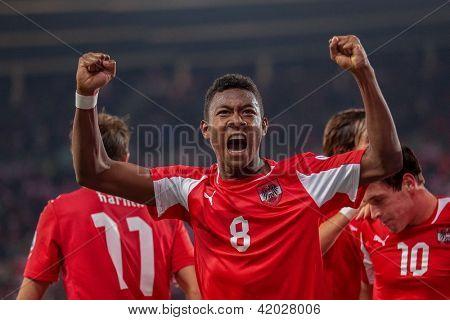 VIENNA,  AUSTRIA - OCTOBER 16: David Alaba (#8 Austria) celebrates after a goal during the WC qualifier soccer game on October 16, 2012 in Vienna, Austria.