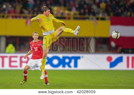 VIENNA,  AUSTRIA - OCTOBER 16:  Sergei Gridin (#11 Kazakhstan) kicks the ball during the WC qualifier soccer game on October 16, 2012 in Vienna, Austria.