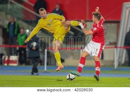 VIENNA,  AUSTRIA - OCTOBER 16:  Mark Gurman (#5 Kazakhstan) and Marko Arnautovic (#7 Austria) fight for the ball during the WC qualifier soccer game on October 16, 2012 in Vienna, Austria.
