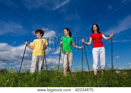 Nordic walking - active family exercising outdoor