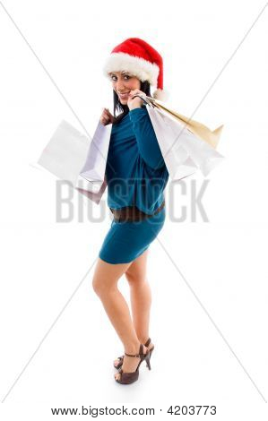 Side Pose Of Christmas Woman Holding Bags On White Background