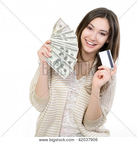 Cheerful attractive young lady holding cash with plastic card and happy smiling over white background