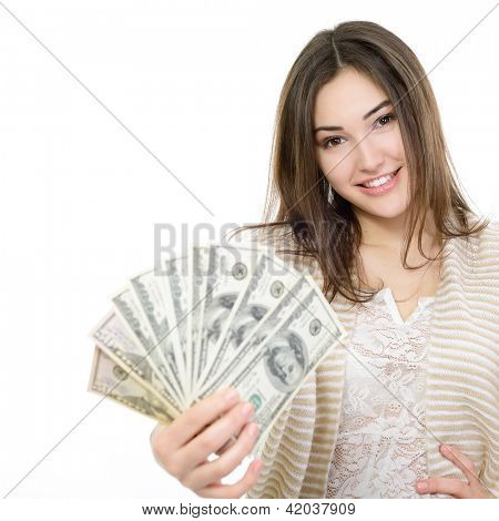 Cheerful attractive young woman holding cash and happy smiling over white background