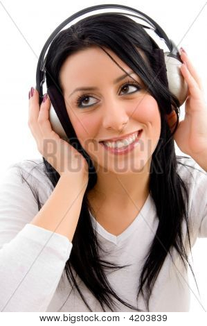 Front View Of Happy Model Listening Music On White Background
