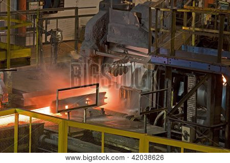 Rolling hot steel bar.
