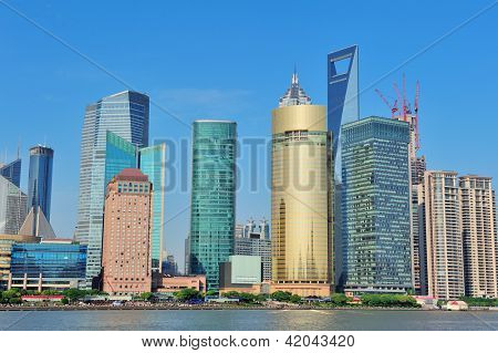 Shanghai skyline with skyscrapers and blue clear sky over Huangpu River.