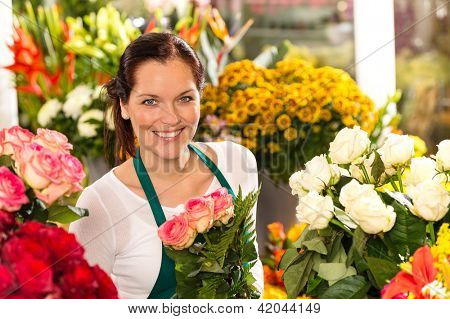 Smiling florist flower shop colorful making bouquet roses market