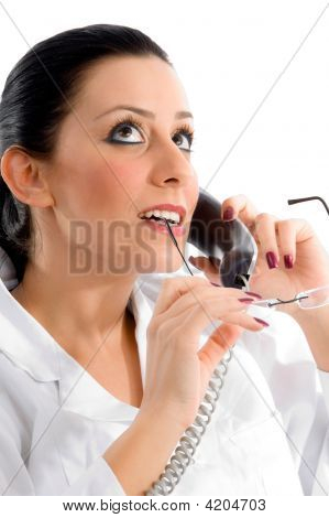 Side Pose Of Doctor Talking On Phone And Looking Upward On White Background