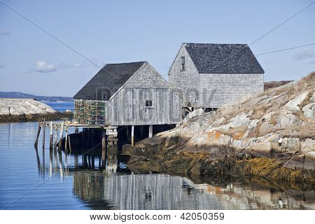 Lobster traps and fishing sheds in the small fishing village and tourism destination of Peggy's Cove, Nova Scotia, Canada.