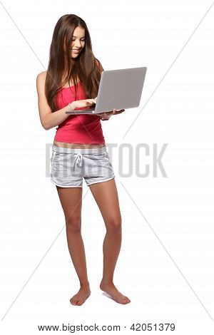 Beautiful Brunette Teenager Girl With Laptop Isolated On White