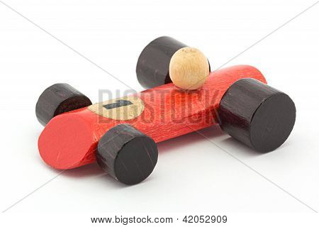 Small Red Wooden Toy Racing Car On White