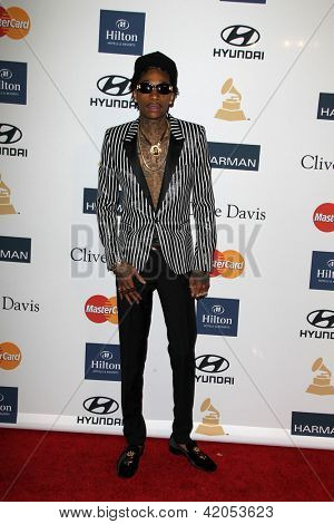 LOS ANGELES - FEB 9:  Wiz Khalifa arrives at the Clive Davis 2013 Pre-GRAMMY Gala at the Beverly Hilton Hotel on February 9, 2013 in Beverly Hills, CA