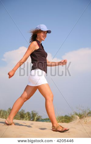 Walking Woman On Sand