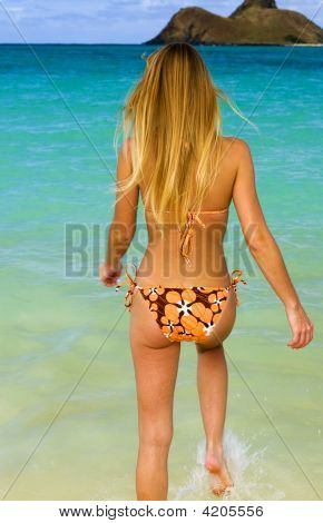 Beautiful Young Blond Woman In A Bikini At A Beach In Hawaii