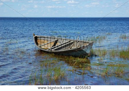 Old Wooden Boat Near The Lake Bank
