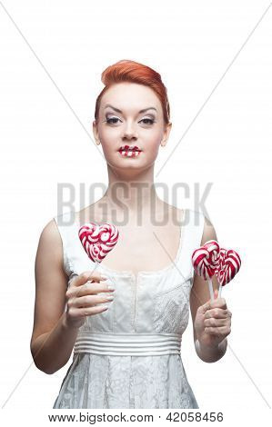 happy red-haired girl holding candy