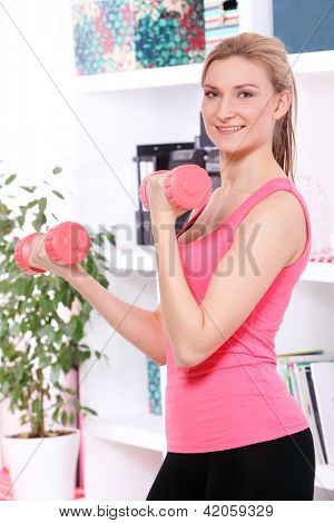 Beautiful middleaged woman doing fitness at home