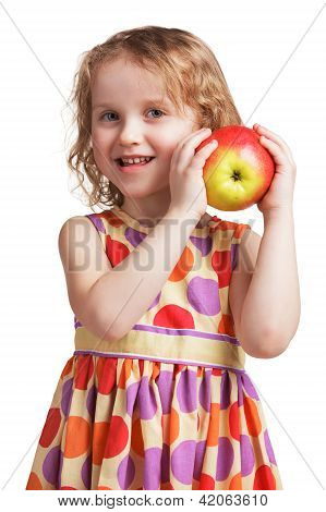 Happy Little Girl With An Apple In His Hand