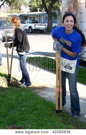 LOS ANGELES - FEB 9:  Theresa Castillo digging new fence post hole at the 4th General Hospital Habitat for Humanity Fan Build Day at the 191 E. Marker Street on February 9, 2013 in Long Beach, CA