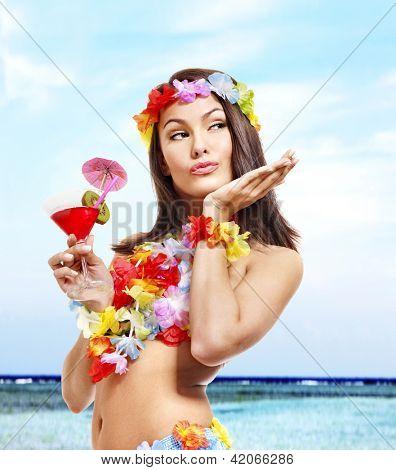 Happy woman in hawaii costume drink  juice.