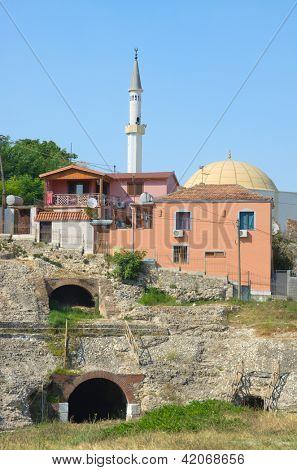 ruins of roman amphitheatre and minaret in Durres, Albania