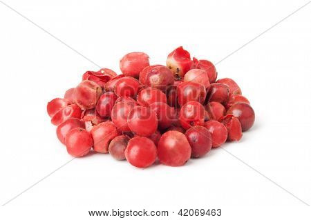 Heap ground pink pepper isolated on white background