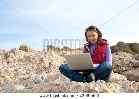 Young Woman Working On A Rock