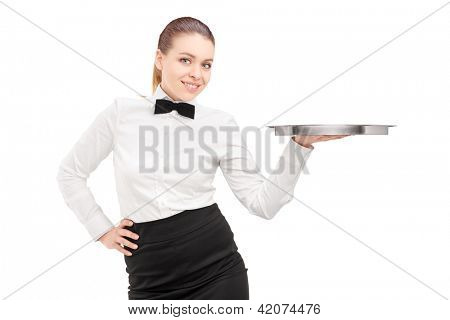 A waitress with bow tie holding an empty tray isolated on white background