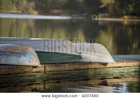 Row Boats On Lake Dock Reflections Trees