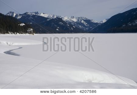 Snowy Lake In The Sunshine